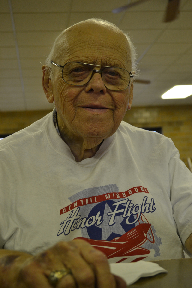 Photo of elderly white man in a white Honor Flight tee shirt.